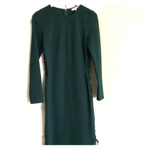 Green form fitting dress